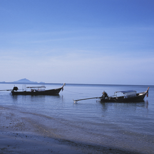 Boats along the beautiful shores of Thailand